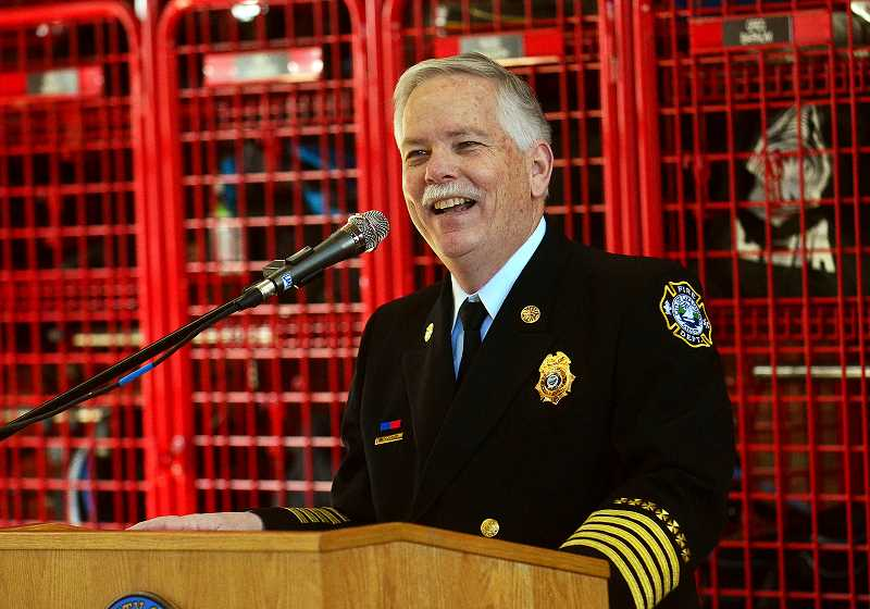 REVIEW PHOTO: VERN UYETAKE - Lake Oswego Fire Chief Larry Goff addresses the crowd during Saturday's promotion ceremony. 'We are so proud of our personnel and this group,' Goff says. 'It's been fantastic to watch the growth of this organization.'