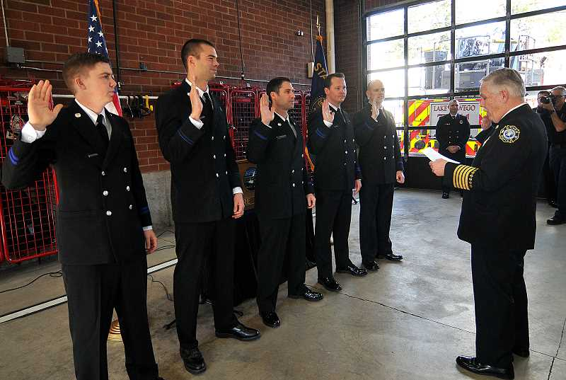REVIEW PHOTO: VERN UYETAKE - New Driver-Engineers Joe Hires (from left), Andrew Owens, Russ Thackery, Ryan Rudge and Jonathan Isbell are sworn in by Fire Chief Larry Goff during a promotion ceremony Saturday in Lake Oswego.