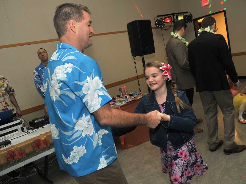 SPOKESMAN PHOTO: VERN UYETAKE - Todd and Lauren, 10,Carroll had fun showing their moves among the other couples on the dance floor.