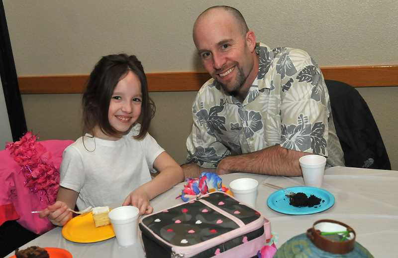 SPOKESMAN PHOTO: VERN UYETAKE - Jeff and Sophia, 7, Miller took a break from the action for some refreshments.