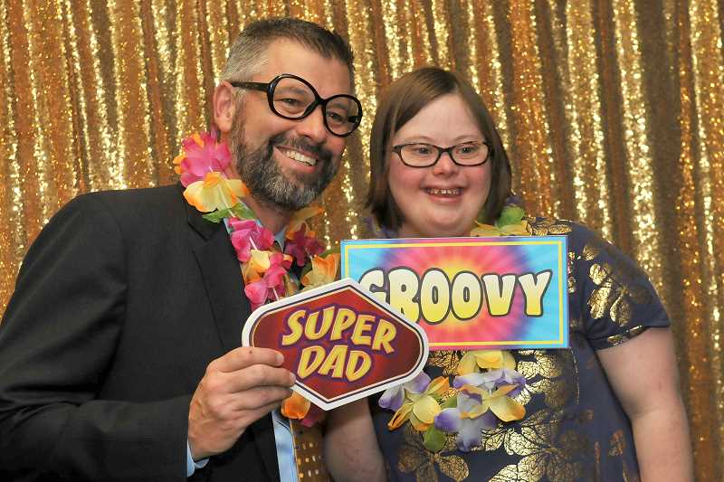 SPOKESMAN PHOTO: VERN UYETAKE - Blake Schellenberg and his daughter Dagny, 25, posed to comemorate the moment at the Daddy Daughter photo booth.