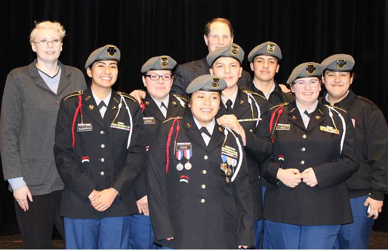 HOLLY M. GILL - Madras High School JROTC students, who attended U.S. Sen. Ron Wyden's Feb. 22 town hall, pose with the senator afterward.