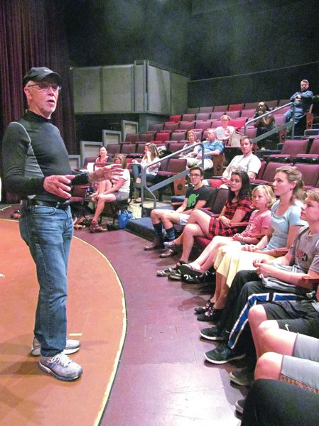 PHOTO BY ELLEN SPITALERI - David Smith-English, CRT artistic director, is shown here talking to young cast members of last years production of 'The Music Man.' He will direct 'Bakersfield Mist,' CRT's first Bar Theatre venture.