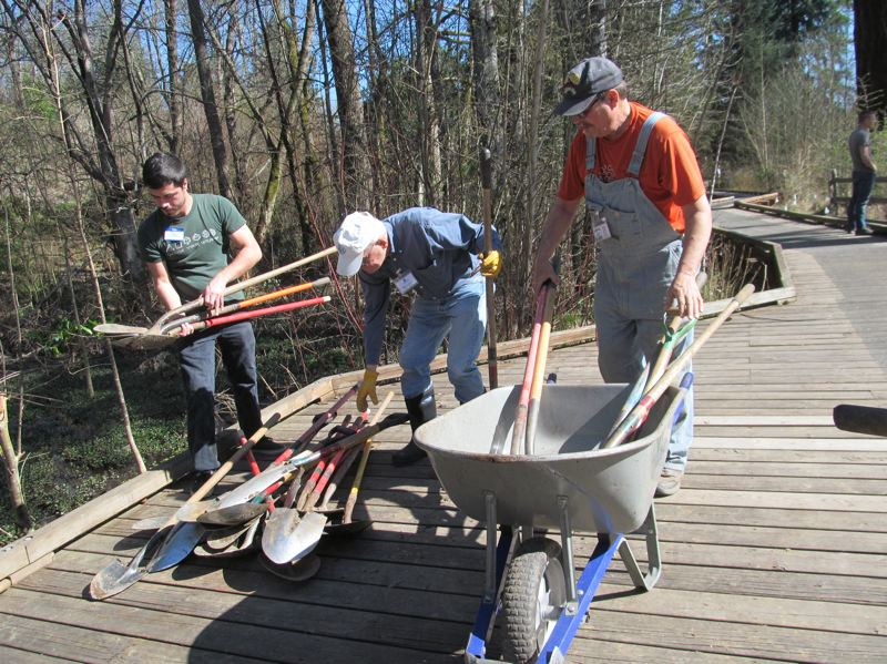 PHOTO BY ELLEN SPITALERI - Pictured above are, left to right, Travis Stoll, Bob Sanders and Russ Stoll. The three men were part of a large watershed workparty at Tideman-Johnson Park in 2015.