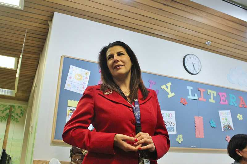 REVIEW PHOTO: KELSEY OHALLORAN - Hilda Pereyo tells girls about some of aviation and aerospace's female pioneers during a presentation Monday at the Lake Oswego Public Library.