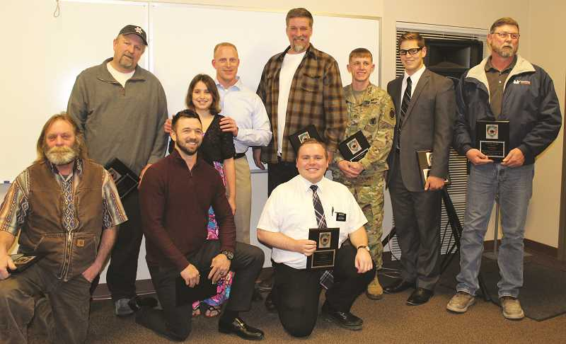 PEGGY SAVAGE - In the back row, Elia Kollias, 10, with her father, Anthony Kollias (second from left), gather with the nine men who saved Elia's life on Nov. 19, 2016. L-R, the heroes are (back row) Michael Tschaggeny, Todd Turcott, Sgt. Ryan Black, Jason Kern and Tim Robinson, and (kneeling) Ty Russell, Brandon Hood and David Fowler.