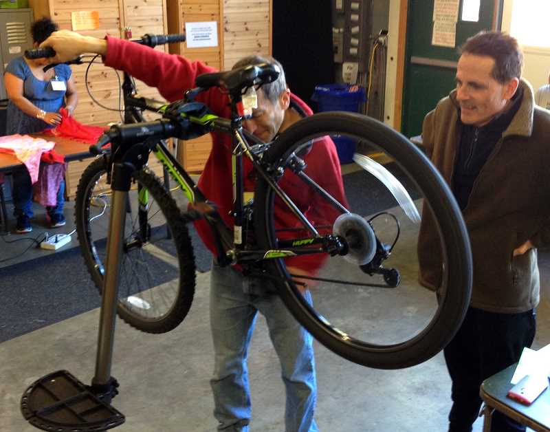 SUBMITTED PHOTO - A dozen volunteer repairers kept busy at Robinwood Stations Repair Fair Feb. 25 in West Linn, helping 60 people reuse their tools, clothing, bicycles and computers needing repair, thus keeping them out of the landfill. In addition, more than 200 pounds of hard-to-recycle items were droppped off.