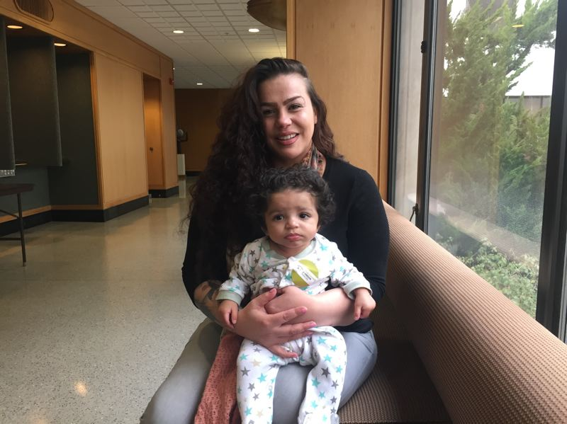 PARIS ACHEN/CAPITAL BUREAU - Coya Crespin and her son, 5-month-old Titan, sit inside the Oregon Capitol in Salem March 2, 2017, during a hearing on a tenant protections bill. Crespin is a tenant at Titan Manor in North Portland, a 72-unit apartment complex where eviction notices were issued to residents in January 2017.