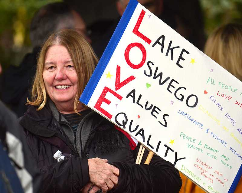 REVIEW PHOTO: VERN UYETAKE - Linda Gustafson of Lake Oswego makes her feelings known at Saturday's 'Stand for LOve' rally in Millenium Plaza Park.