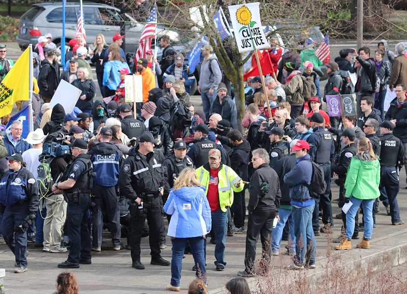 REVIEW PHOTO: BRIAN MONIHAN - Police try to keep pro-Trump marchers and counter-protesters separated Saturday after both groups converged on lower Millenium Plaza Park. Despite several confrontations throughout the day, officers only made three arrests.