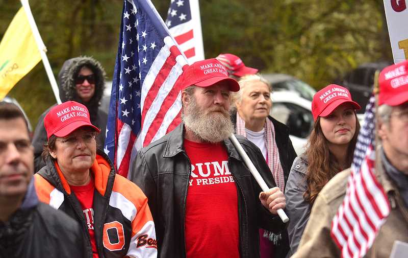 REVIEW PHOTO: VERN UYETAKE - 'March 4 Trump' participants listen to speakers Saturday in George Rogers Park before heading out toward State Street.