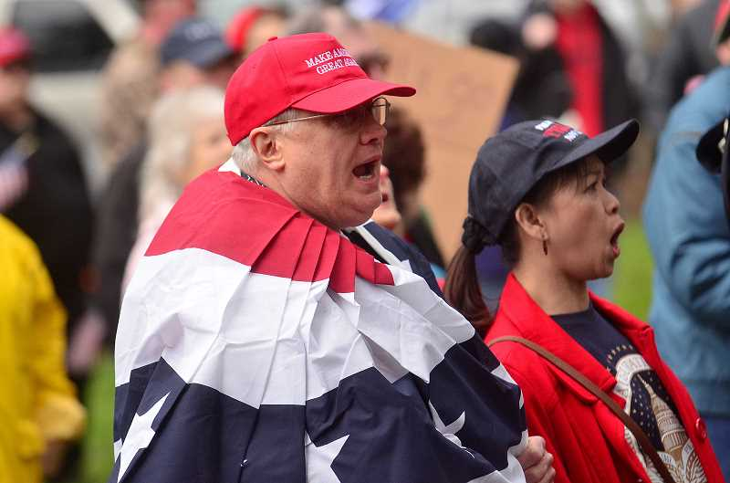 REVIEW PHOTO:  VERN UYETAKE - Saturday's 'March 4 Trump' started with the Pledge of Allegiance, The Lord's Prayer and the singing of the National Anthem.
