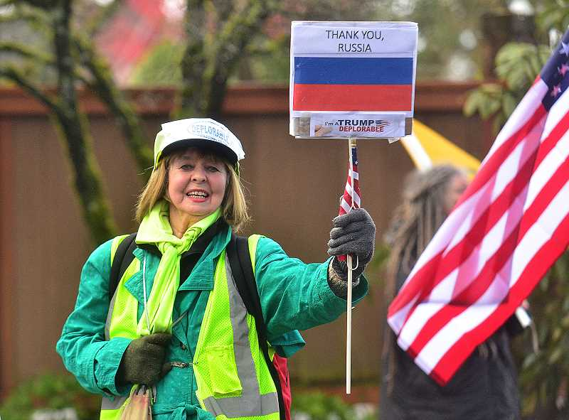 REVIEW PHOTO: VERN UYETAKE - Gloria Warner of Southeast Portland shows her support for President Trump and for whatever role Russia may have played in his election.