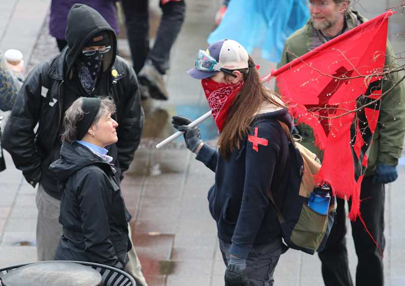 REVIEW PHOTO: BRIAN MONIHAN - A 'Stand for LOve' supporter confronts masked protesters Saturday in Lake Oswego.