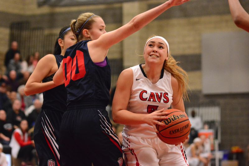 PAMPLIN MEDIA: DAVID BALL - Clackamas senior Madeline Oakden drives the lane against Westviews Katie McConnell during the Cavaliers 66-52 playoff win Saturday.