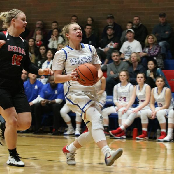 REVIEW/NEWS PHOTO: JIM BESEDA - La Salle Prep's Emily NIbergall drives to the basket for two of her nine points in Saturday's 59-35 playoff win over Central.