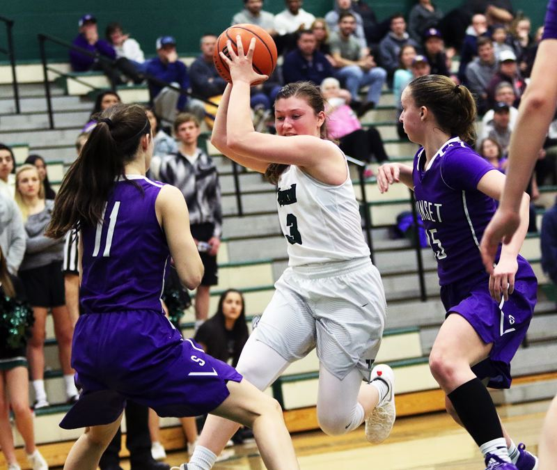 DAN BROOD - Tigard sophomore Campbell Gray (3) looks to drive between Sunset seniors Amanda Carpenter (11) and Maddie Muhlheim during Saturday's state playoff game. Gray scored a game-high 24 points in the contest.