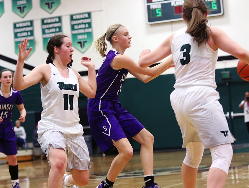 DAN BROOD - Sunset freshman Mary Kay Naro passes the ball as she's pressured by Tigard sophomores Paige LaFountain (11) and Campbell Gray.