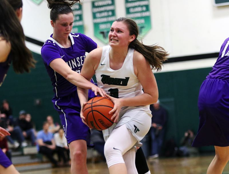 DAN BROOD - Tigard sophomore Campbell Gray looks to get past Sunset senior Maddie Muhlheim during Saturday's state playoff game.