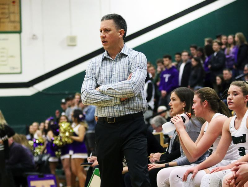 DAN BROOD - Tigard coach Steve Naylor, the Three Rivers League Coach of the Year, watches the action during Saturday's state playoff game.