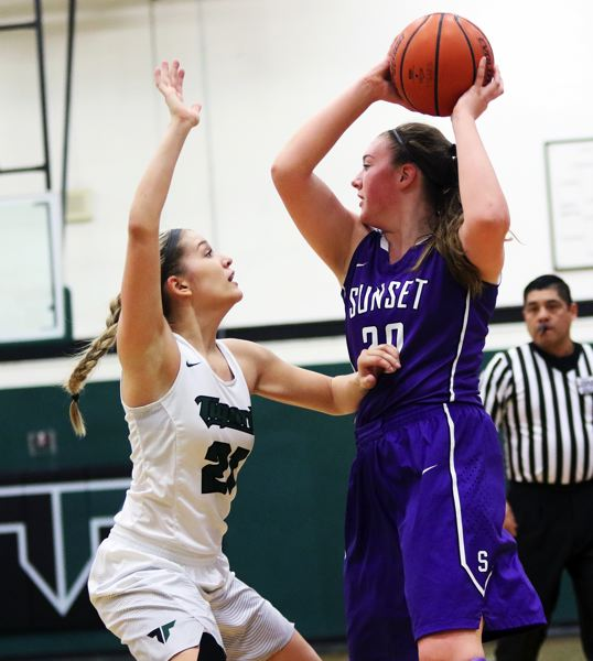 DAN BROOD - Tigard senior Kylie Warren (left) plays tight defense against Sunset sophomore Ellie Mead during Saturday's state playoff game.
