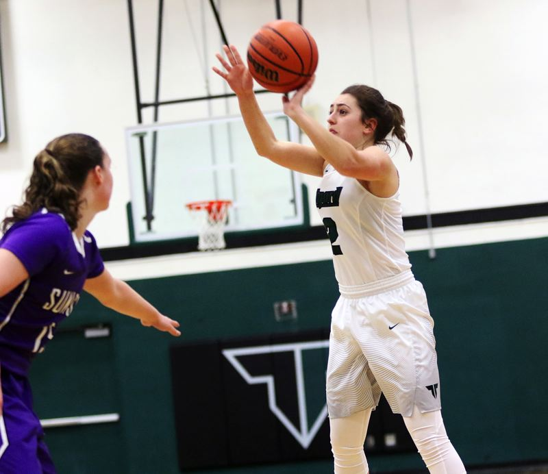 DAN BROOD - Tigard senior Abby Portwood connects on a three-pointer during Saturday's state playoff game.