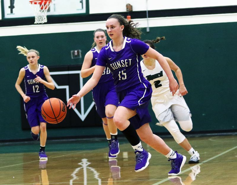 DAN BROOD - Sunset senior Maddie Muhlheim brings the ball up court on a fast break during Saturday's state playoff game at Tigard.