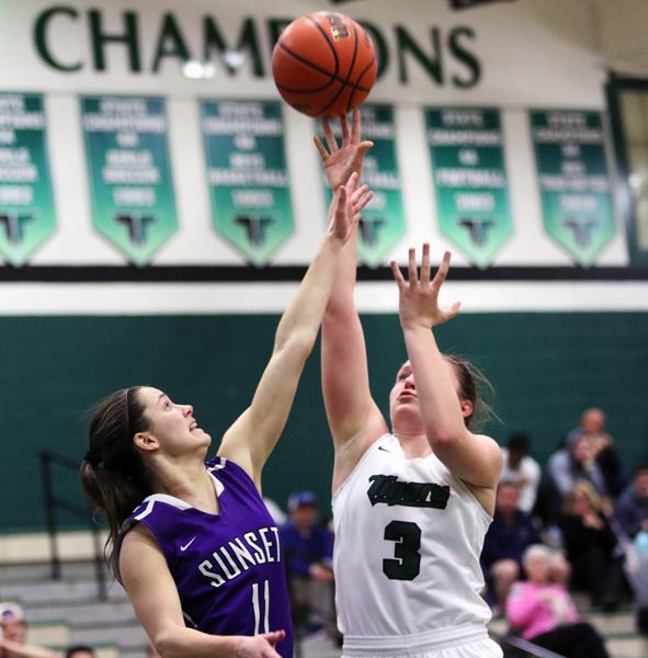 DAN BROOD - Tigard sophomore Campbell Gray (right) takes a shot over Sunset senior Amanda Carpenter.
