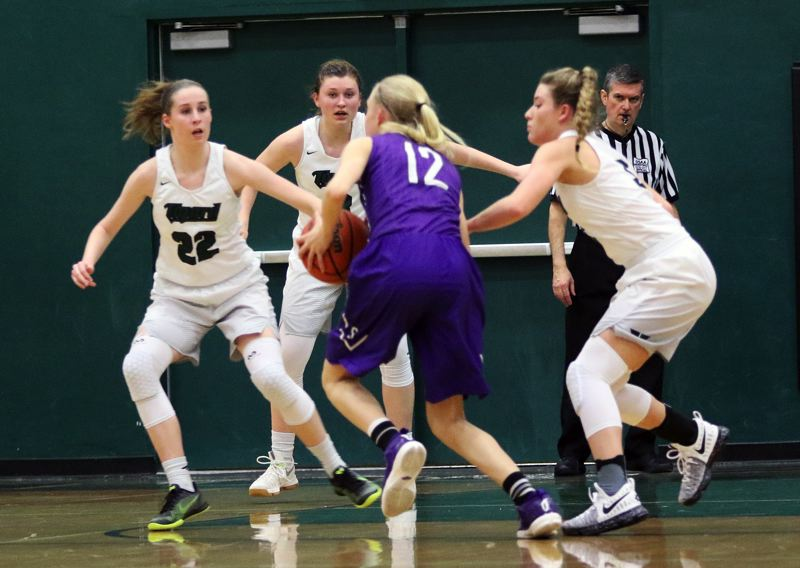 DANB BROOD - Sunset freshman Mary Kay Naro (12) is surrounded by Tigard's (from left) Delaney Leavitt, Campbell Gray and Gabby McGaughey.