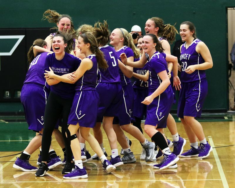 DAN BROOD - The Sunset High School girls basketball team starts celebrating following the 56-49 state playoff win at Tigard on Saturday.