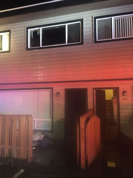 PHOTO COURTESY: CLACKAMAS FIRE - The window of a Milwaukie apartment's second-story bedroom was broken out after a Saturday fire.
