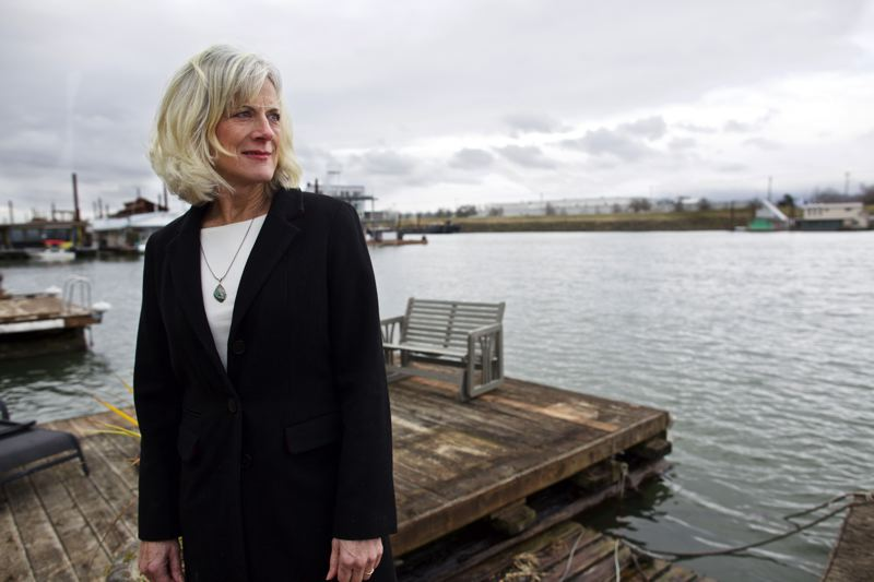 TRIBUNE PHOTO: JAIME VALDEZ - Mary Lou Putman lives on a houseboat on Hayden Island, about a quarter mile downwind from two oil recycling plants that she says are sending nauseating fumes to the area.