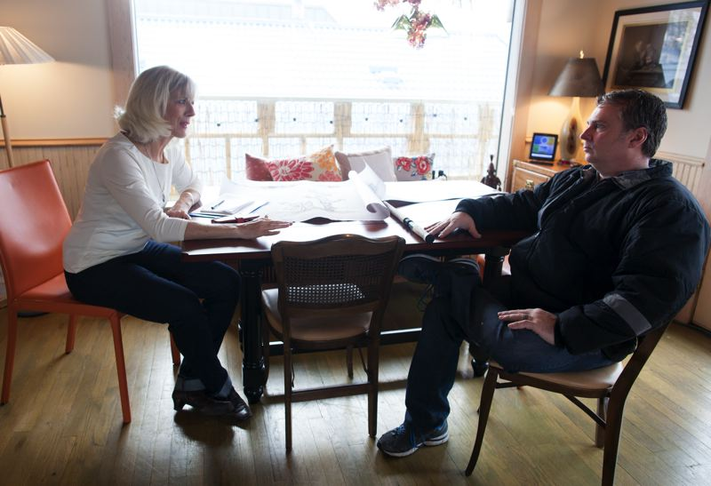 TRIBUNE PHOTO: JAIME VALDEZ - Mary Lou Putman and her neighbor, Randy Roy, talk about their next plan of attack to combat odors coming from two oil reprocessing plants in North Portland.