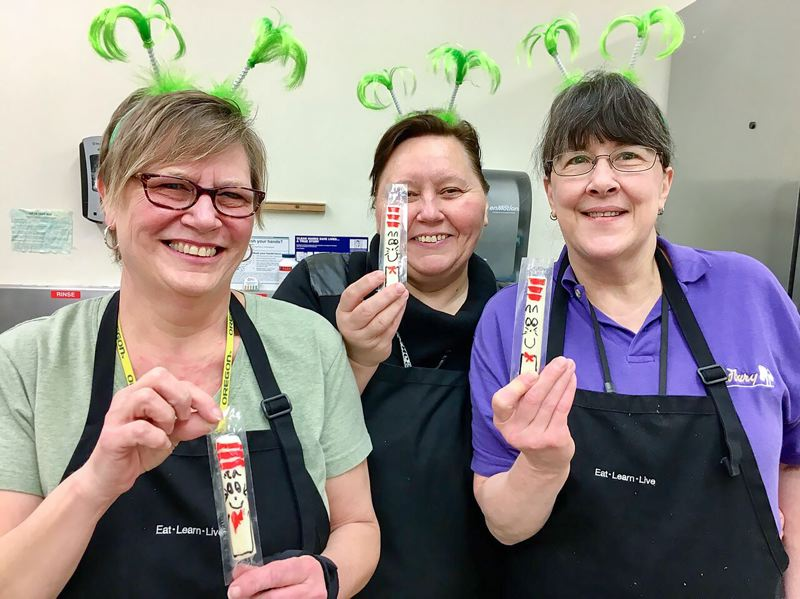 CONTRIBUTED - The lunch ladies at Margaret Scott get into the birthday celebration with their 'Cat in the Hat' string cheese.