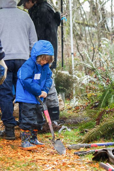 OUTLOOK PHOTO - Many families came out to volunteer during the 19th-annual Watershed Wide event.