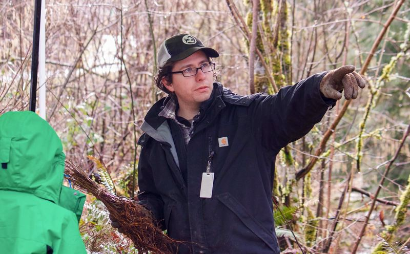 OUTLOOK PHOTO - Jesse Seals, a city of Gresham AmeriCorps volunteer, helped guide participants at Springwater Woods.
