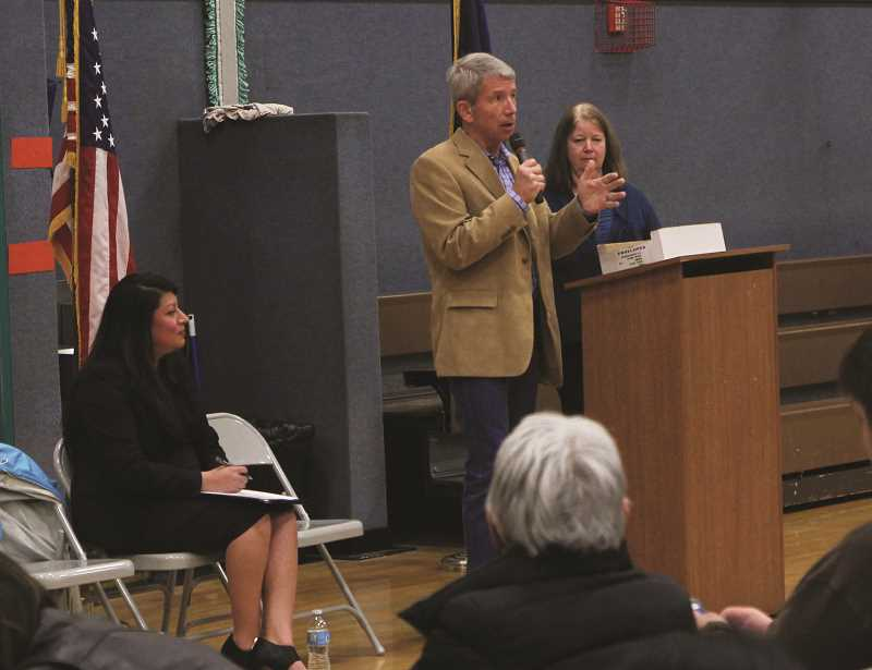 INDEPENDENT PHOTO: JULIA COMNES - (From left) State Rep. Teresa Alonso Leon, U.S. Rep. Kurt Schrader and Woodburn Mayor Kathy Figley addressed a crowd of about 100 people at a town hall meeting on Saturday morning.