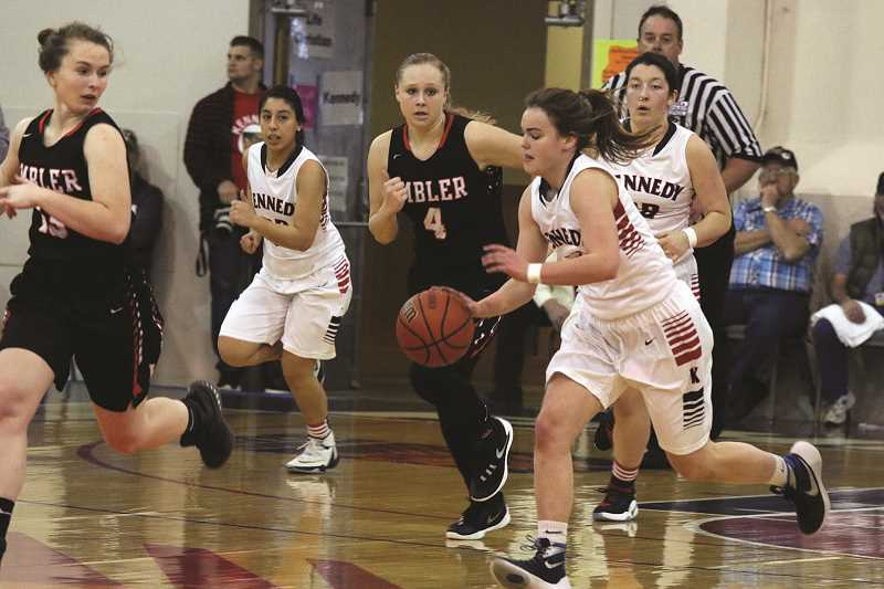 JODI ARRITOLA - Kennedy junior Hannah Arritola takes the ball up the court in the Trojans' 39-30 victory over Imbler in Saturday's third-place game against the Imbler Panthers in the 2A state tournament in Pendleton.