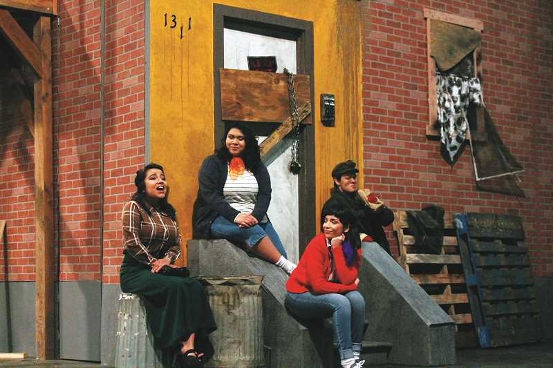 PIONEER PHOTO: CONNER WILLIAMS - L-R: Diana Sanchez as Audrey, Sophia Cortes as Crystal, Jennifer Chavez as Chiffon, and Marshall MacDonald as a drifter rehearse a scene from the upcoming Molalla Thespian Association's production of 'Little Shop of Horrors.'