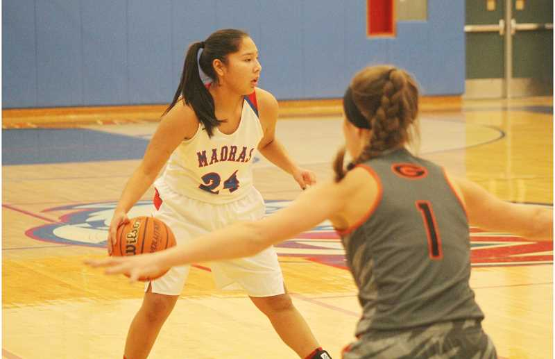 WILL DENNER/MADRAS PIONEER - Madras freshman Jiana Smith-Francis (24) made an immediate impact for the Buffs in her first couple high school games and never looked back. Smith-Francis averaged 10 points and 4.8 rebounds for the season, good enough for second-team TVC honors.