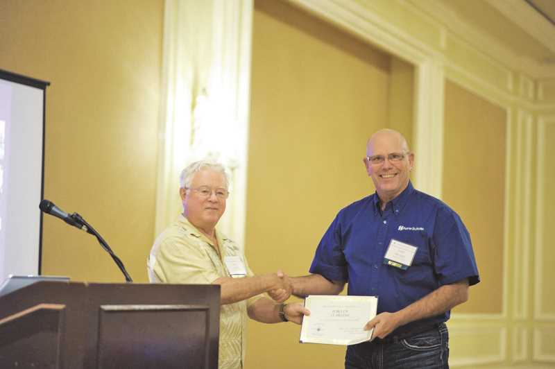 ASSOCIATION OF PACIFIC PORTS PHOTO - Port of St. Helens Commissioner Larry Ericksen, right, accepts an award during the Association of Pacific Ports Winter Conference in Maui, Hawaii. The Port spent $13,000 for three commissioners and its executive director, Patrick Trapp, to attend the annual event, which included fishing trips, golf outings and stays at a luxury hotel.