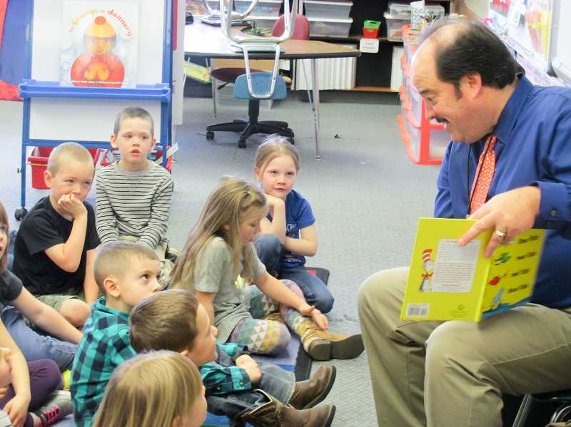 ESTACADA NEWS PHOTO: EMILY LINDSTRAND - On Wednesday, March 1, Mayor Sean Drinkwine stopped by kindergarten classes at River Mill Elementary School to read 'One Fish Two Fish Red Fish Blue Fish' as a part of the schools Read Across America festivities.