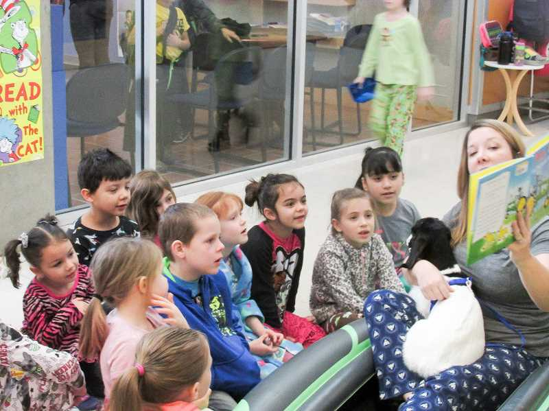 ESTACADA NEWS PHOTO: EMILY LINDSTRAND - Students at Clackamas River Elementary School were all smiles as Principal Amy Hudson read to BB the baby goat.