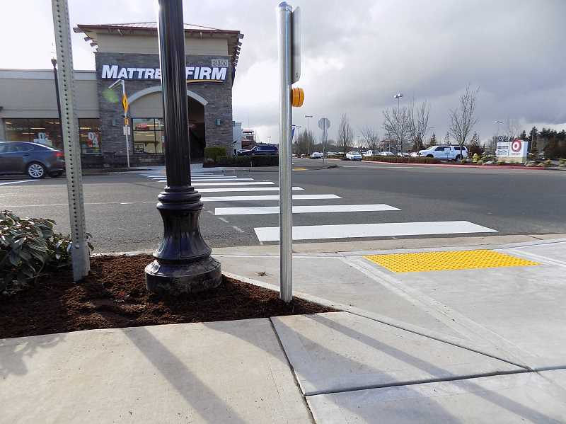 GAZETTE PHOTO: RAY PITZ - Along with an RRFB, or Rectangular Rapid Flashing Beacon, city crews installed a crosswalk to highlight the area where pedestrians cross from the Walmart to the Target shopping complexes.