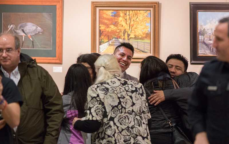 HILLSBORO TRIBUNE PHOTO: CHASE ALLGOOD - Triumphant sanctuary city supporters hug each other after the council passed Resolution 2552 Tuesday.