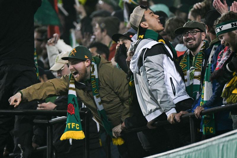 TRIBUNE PHOTO: JOSH KULLA - Portland Timbers fans, though wet, had plenty to cheer about as their team buried Minnesota United 5-1 to add to its preseason momentum.