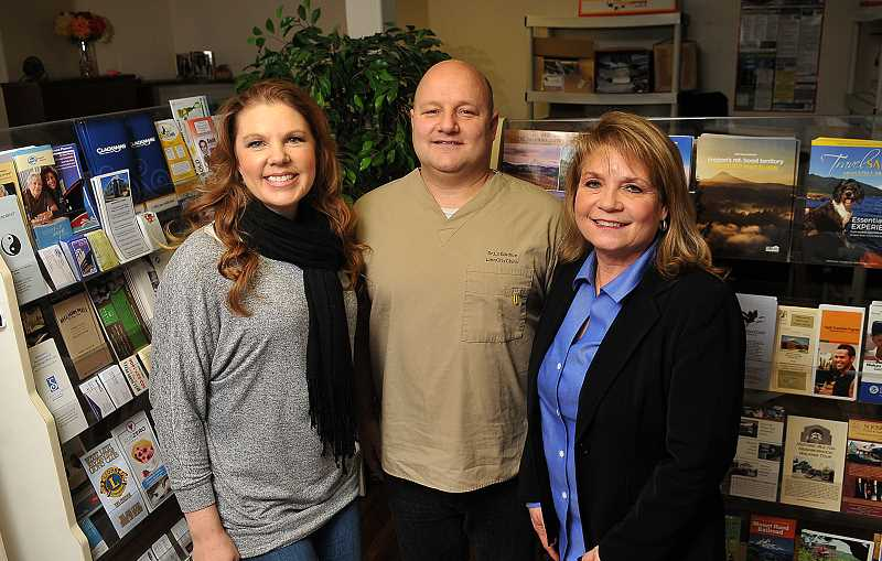 STAFF PHOTOS: VERN UYETAKE  - From left, West Linn Chamber of Commerce Office and Communications Coordinator Melinda Doblie stands with chamber President Michael LoGuidice and Vice President Molly Macom. The chamber is dedicated to building membership and offering members more value for their dues.
