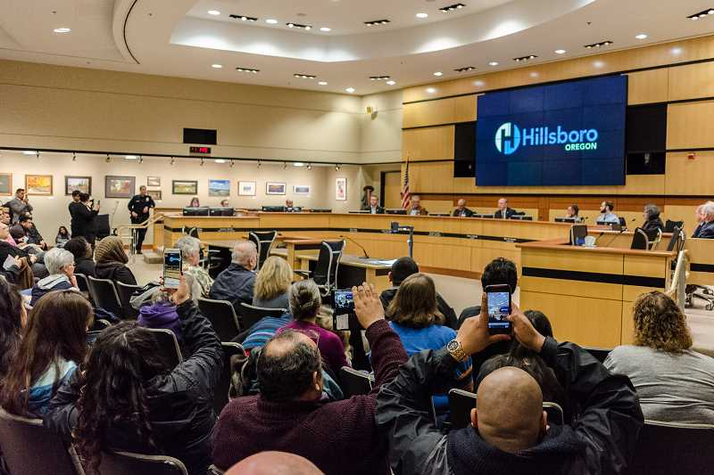 HILLSBORO TRIBUNE PHOTO: CHASE ALLGOOD - Residents take photos and videos as the Hillsboro city council votes to become a sanctuary city on Tuesday, March 7.