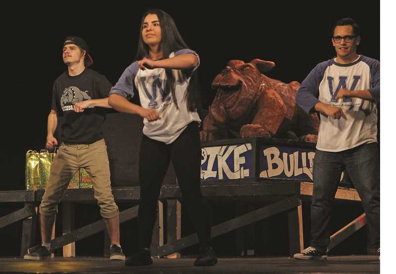 INDEPENDENT PHOTO: JULIA COMNES - The pageant began with all of the candidates performing an opening dance number. (From left) Success Alternative High School's Chris Leiss and WeBSS's Ana Rojas and Joel Cruz dance to 'Can't Stop the Feeling' by Justin Timberlake.