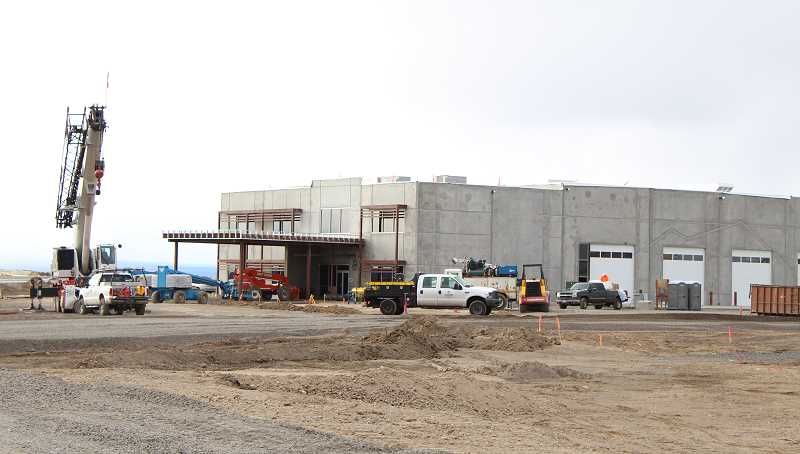 HOLLY M. GILL - Kirby Nagelhout Construction is working long hours and weekends to complete  Daimler Trucks North America's new, $18.7 million facility at the Madras airport by mid-April.